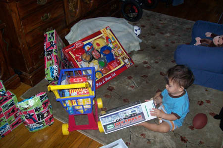 Opening the other gifts - 2008 Hess Truck (grandpa)